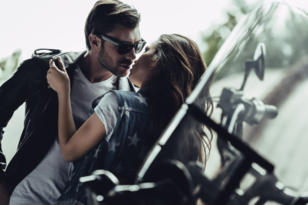 How your Enneagram type influences your sex life as shown with a couple kissing on a bike