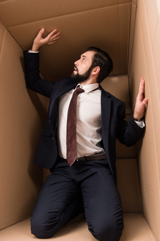 man trapped in a box Enneagram for parents and couples
